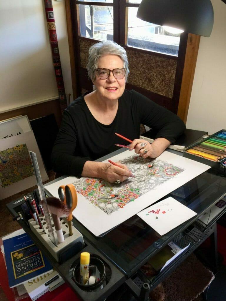 Hilde Ranson illustrating at her drawing desk